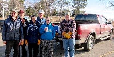 volunteers gathered by new truck ready for work