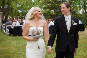 A newly married couple walks down the aisle at Holy Wisdom Monastery, a Madison wedding venue.