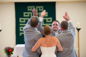 Wedding high-fives in the Assembly Room of Holy Wisdom Monastery.