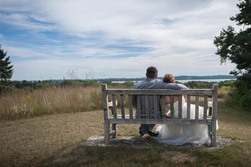 Newly married couple enjoys a view of Lake Mendota from Holy Wisdom Monastery, a Madison WI wedding venue.