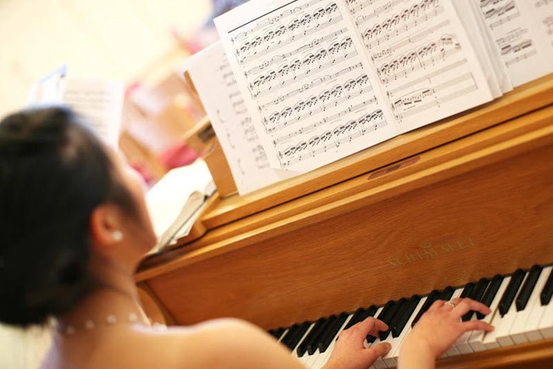 Pianist plays at a wedding in Madison, Wisconsin.