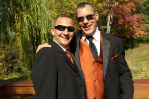 Two men in suits enjoying a wedding at Holy Wisdom Monastery in Middleton, WI