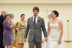 Bride and groom walk down the aisle at Holy Wisdom Monastery, a Madison WI wedding venue