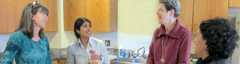 Sisters and sojourners share conversation over breakfast preparations