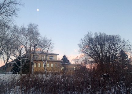 glow of sunset and a full moon over the retreat and guest house