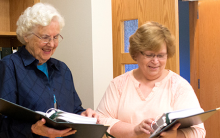 Sister Joanne introduces retreatant to prayer books used for daily prayer