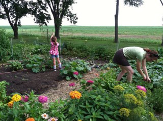 Sherri Hansen gardens with her niece Cadia Rose in their main farm garden in Sauk Prairie, Wisconsin.