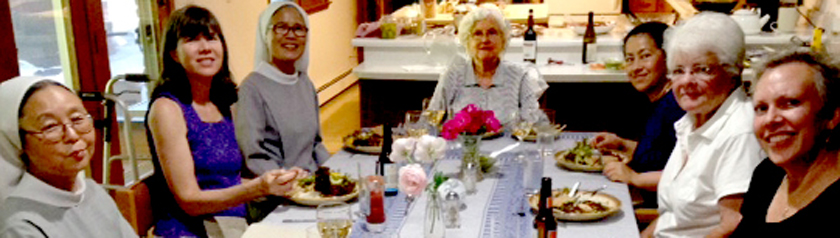 Sisters and guests seated around the dinner table