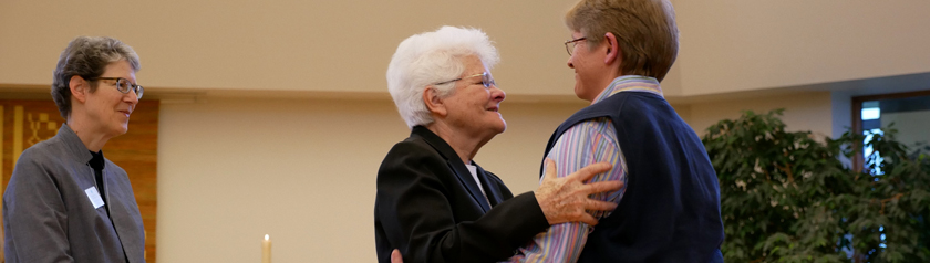 Susan Pearson receives a hug from Sister Mary David Walgenbach with Sister Lynne Smith standining close by.